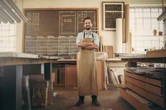 Confident craftsman standing in his workshop studio Stock Images