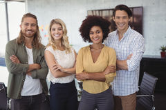 Confident creative team standing in office stock images