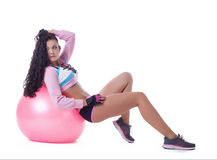 Confident curly brunette posing with sport ball Stock Image
