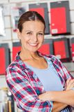 Confident Customer With Arms Crossed In Hardware Royalty Free Stock Images