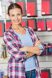 Confident Customer With Arms Crossed In Hardware Royalty Free Stock Photo