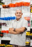 Confident Customer With Arms Crossed Hardware Shop Stock Photography