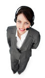 Confident customer service agent using a headset Royalty Free Stock Photo