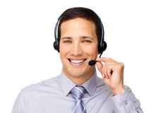 Confident customer service agent using headset. Against a white background Royalty Free Stock Images