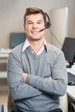 Confident Customer Service Representative Sitting Stock Photography