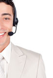 Confident customer service representative using he Royalty Free Stock Photography