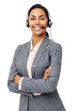 Confident Customer Service Representative Wearing Headset. Portrait of confident female customer service representative wearing headset with arms folded against Stock Image