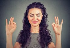 Confident cute young woman meditating happily royalty free stock image