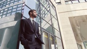 Confident delighted businessman standing near entrance door stock footage