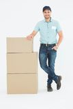 Confident delivery man with cardboard boxes Stock Photos