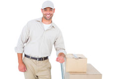 Confident delivery man with cardboard boxes Royalty Free Stock Images