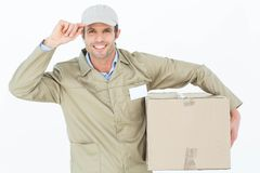 Confident delivery man carrying cardboard box Royalty Free Stock Images