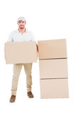 Confident delivery man holding cardboard box Royalty Free Stock Image