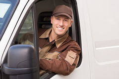 Confident Delivery Man Smiling In Truck Stock Photos