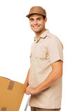 Confident Deliveryman With Cardboard Box Stock Photography