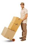 Confident Deliveryman Delivering Cardboard Boxes Royalty Free Stock Photography