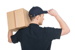 Confident deliveryman. Rear view of young deliveryman holding ca Royalty Free Stock Image
