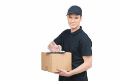 Confident deliveryman at work. Cheerful young deliveryman holdin Royalty Free Stock Photo