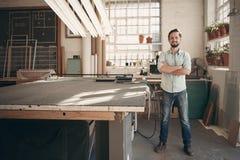 Confident designer standing in his workshop studio Royalty Free Stock Image