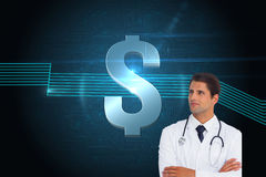 Confident doctor with arms crossed looking up Royalty Free Stock Photography