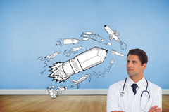 Confident doctor with arms crossed looking up Stock Photo