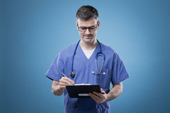 Confident doctor with clipboard Royalty Free Stock Photo