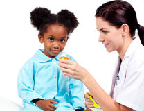 Confident doctor giving medicine to her patient Stock Photo