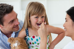 Confident doctor giving medicine to a little girl. In the hospital Stock Photo