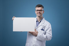 Confident doctor holding a sign Royalty Free Stock Images