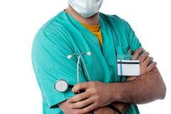 Confident doctor holding stethoscope Stock Photo