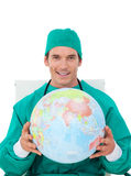 Confident doctor holding terrestrial globe Royalty Free Stock Images