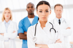 Confident doctor leading her team. Stock Photo