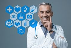 Confident doctor and medical icons Stock Photo