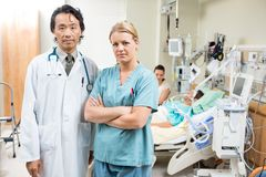 Confident Doctor And Nurse With Patient Resting In Royalty Free Stock Photos