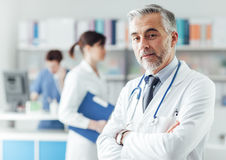 Confident doctor in the office Royalty Free Stock Image