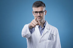 Confident doctor pointing Royalty Free Stock Images