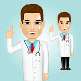 Confident doctor pointing up Stock Image