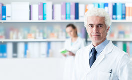 Confident doctor posing in his office Royalty Free Stock Images