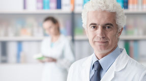 Confident doctor posing in his office Stock Photo