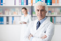 Confident doctor posing in his office Stock Photography