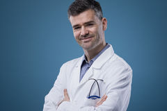Confident doctor posing Stock Images