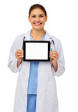 Confident Doctor Showing Digital Tablet Stock Photography