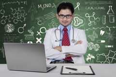 Confident doctor sitting in class Royalty Free Stock Images