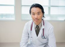 Confident Doctor Sitting In Hospital Room Royalty Free Stock Photos