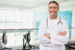 Confident doctor standing in fitness studio Royalty Free Stock Photography