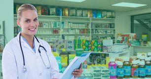 Confident doctor standing at pharmacy. Digital composite of Confident doctor standing at pharmacy Royalty Free Stock Photo