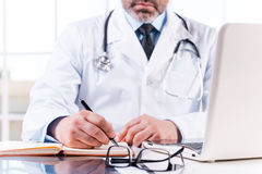 Confident doctor at work. Royalty Free Stock Photos