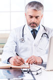 Confident doctor at work. Stock Image