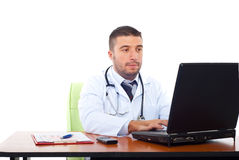 Confident doctor working on laptop Royalty Free Stock Images