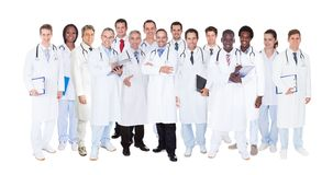 Confident doctors against white background Royalty Free Stock Photography